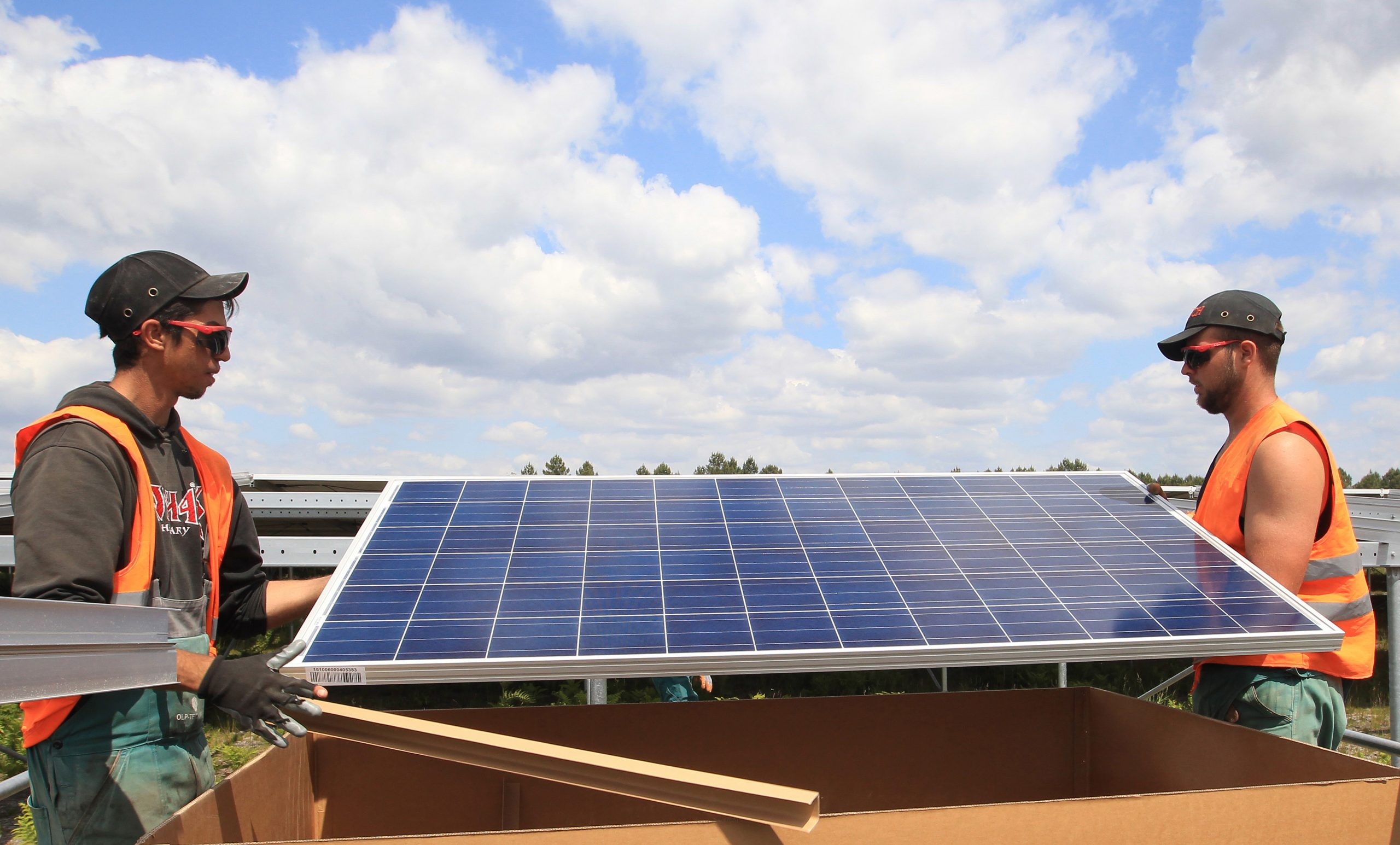 Workers install solar panels at the Constantine photovoltaic power station in Cestas, near Bordeaux, southwestern France, Friday, May 22, 2015. Once operational, the Constantine plant is set to be the largest ground-mounted photovoltaic installation across Europe. (AP Photo/Bob Edme)